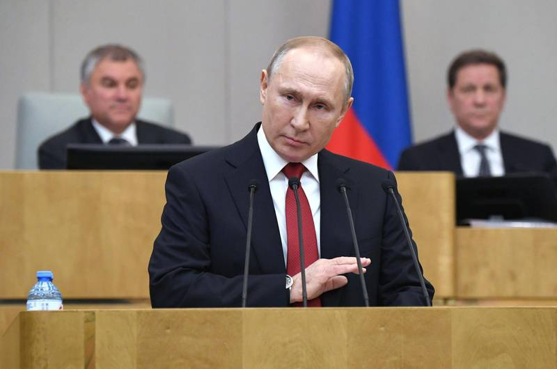 TOPSHOT - Russian President Vladimir Putin addresses lawmakers debating on the second reading of the constitutional reform bill during a session of the State Duma, Russia's lower house of parliament, in Moscow on March 10, 2020. / AFP / SPUTNIK / Alexey NIKOLSKY