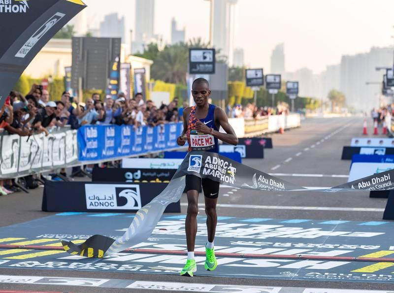 Abu Dhabi, United Arab Emirates - December 06, 2019: Reuben Kipyego from Kenya wins the mens ADNOC Abu Dhabi marathon 2019. Friday, December 6th, 2019. Abu Dhabi. Chris Whiteoak / The National