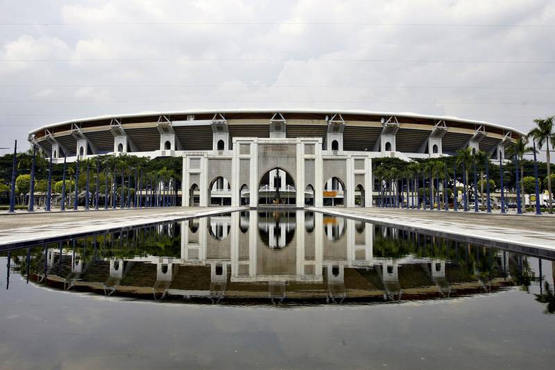 The Bukit Jalil National Stadium, primary venue for the 2007 AFC Asian Cup 2007 matches co-hosted by Malaysia, is seen by a reflecting pool in Bukit Jalil, near Kuala Lumpur, 17 May 2007. The 2007 AFC Asian Cup will be held this 07-29 July, and co-hosted by Indonesia, Malaysia, Thailand and Vietnam. AFP PHOTO/TENGKU BAHAR (Photo by TENGKU BAHAR / AFP)