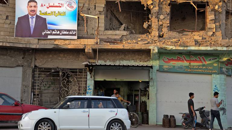 An image that illustrates this article Mosul residents sceptical of election candidates' promises to rebuild city