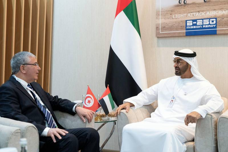 ABU DHABI, UNITED ARAB EMIRATES - February 18, 2019: HH Sheikh Mohamed bin Zayed Al Nahyan, Crown Prince of Abu Dhabi and Deputy Supreme Commander of the UAE Armed Forces (2nd R) speaks with HE Abdul Karim Al-Zubaidi, Minister of Defense of Tunisia (2nd L), during the 2019 International Defence Exhibition and Conference (IDEX), at Abu Dhabi National Exhibition Centre (ADNEC). Seen with HE Mohamed Mubarak Al Mazrouei, Undersecretary of the Crown Prince Court of Abu Dhabi (R). ( Rashed Al Mansoori / Ministry of Presidential Affairs ) ---