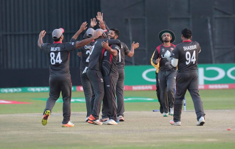 UAE players celebrate after winning their cricket world cup qualifier match against Zimbabwe at Harare Sports Club, Thursday, March, 22, 2018. Zimbabwe is playing host to the 2018 Cricket World Cup Qualifier matches featuring 10 countries. (AP Photo/Tsvangirayi Mukwazhi)