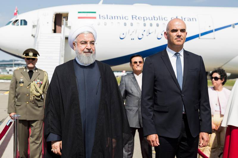 epa06858199 Swiss Federal President Alain Berset (R) welcomes Iranian President Hassan Rouhani (L) during his visit to Switzerland at the Zurich airport in Kloten, Switzerland, 02 July 2018. Rouhani arrived for a two-day visit.  EPA/PETER KLAUNZER