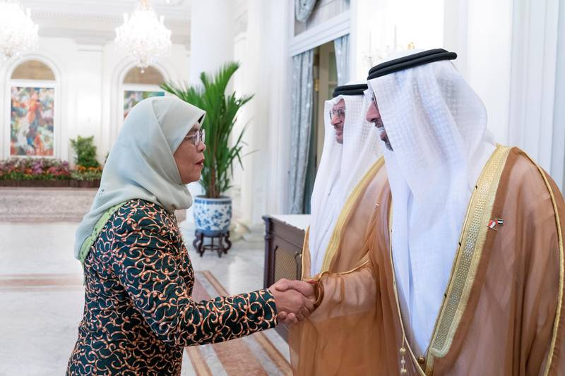 SINGAPORE, SINGAPORE - February 28, 2019: HE Halimah Yacob, President of Singapore (L), greets HE Suhail bin Mohamed Faraj Faris Al Mazrouei, UAE Minister of Energy (R), prior to a meeting, at the Istana presidential palace.  ( Mohamed Al Hammadi / Ministry of Presidential Affairs ) —