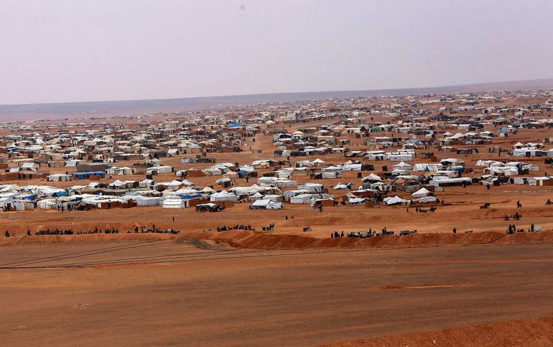 FILE - This file picture taken Tuesday, Feb. 14, 2017, shows an overview of the informal Rukban camp, between the Jordan and Syria borders. Statements issued by the United Nations and the Syrian Arab Red Crescent said their joint convoy reached Rukban camp and would deliver assistance to 50,000 people The convoy was supposed to arrive last week but was delayed due to logistics and security concerns. The U.N. said the operation is expected to take three to four days. (AP Photo/ Raad Adayleh, File)