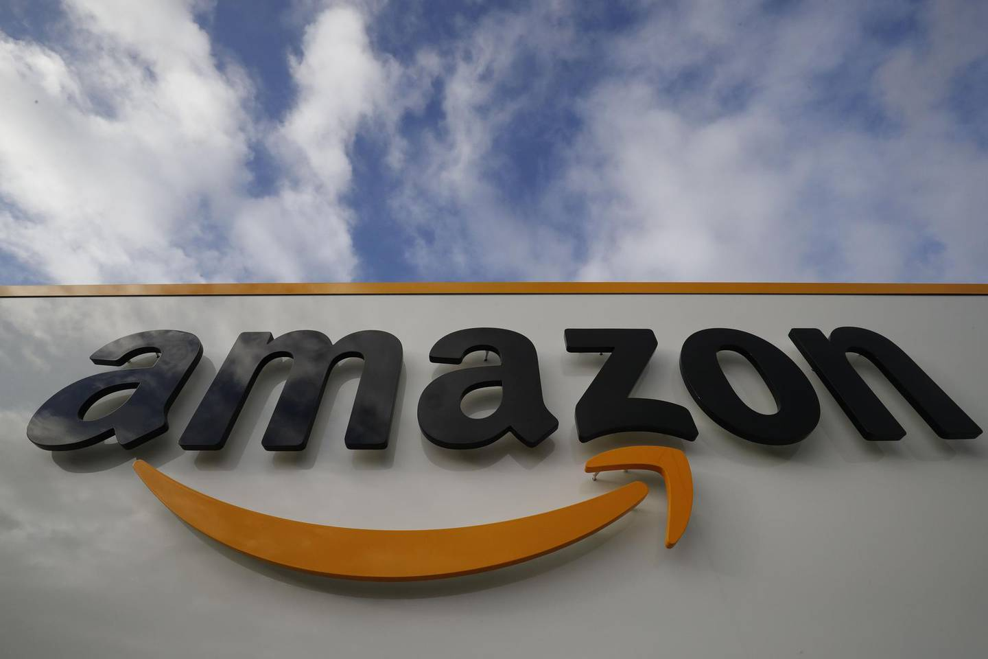 (FILES)This file photo taken on November 28, 2019,  shows the Amazon logo at one of the company's centre in Bretigny-sur-Orge. US logistics giant Amazon announced on April 27, 2020, that it was extending until May 5, 2020, the suspension of activity at its distribution centres in France, after a court decision requiring it to assess the risks associated with the COVID-19 outbreak, caused by the novel coronavirus.  / AFP / Thomas SAMSON