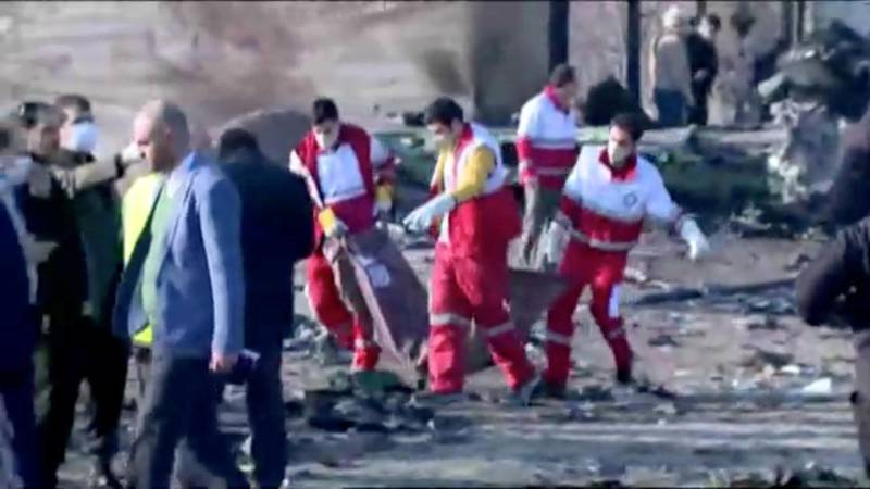 Emergency workers work near the wreckage of Ukraine International Airlines flight PS752, a Boeing 737-800 plane that crashed after taking off from Tehran's Imam Khomeini airport on January 8, 2020, in this still image taken from Iran Press footage.   Iran Press/Handout via REUTERS   NO RESALES. NO ARCHIVES. THIS IMAGE HAS BEEN SUPPLIED BY A THIRD PARTY. IRAN OUT. NO COMMERCIAL OR EDITORIAL SALES IN IRAN. NO USE BBC PERSIAN. NO USE MANOTO. NO USE VOA PERSIAN. NO USE IRAN INTERNATIONAL.?
