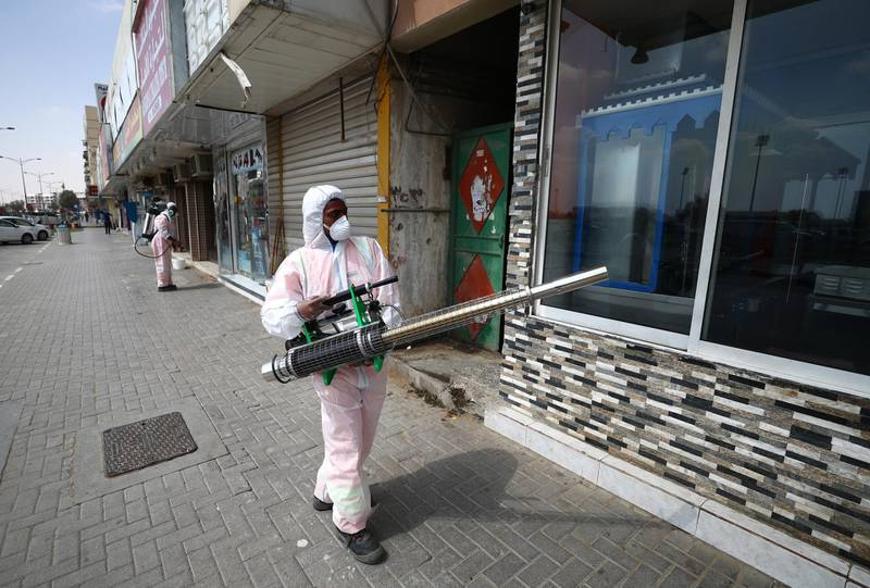 SHARJAH, UNITED ARAB EMIRATES - MARCH 25:  A worker sprays disinfectant, as a preventive measure against the spread of COVID-19 on March 25, 2020 in Sharjah, United Arab Emirates. The Coronavirus (COVID-19) pandemic has spread to at least 182 countries, claiming over 18,000 lives and infecting hundreds of thousands more. (Photo by Francois Nel/Getty Images)