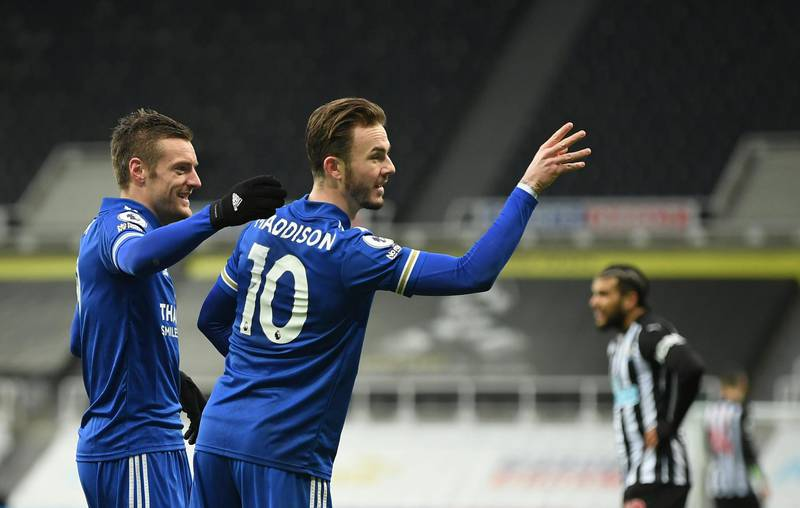 Leicester's James Maddison, centre, celebrates with Jamie Vardy after scoring his side's opening goal during the English Premier League soccer match between Newcastle United and Leicester City at St. James' Park in Newcastle, England, Sunday, Jan. 3, 2021. (Michael Regan/Pool via AP)