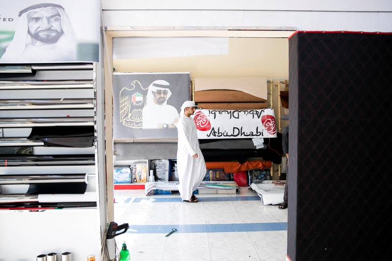 ABU DHABI, UNITED ARAB EMIRATES - NOVEMBER 27, 2018.   Mohammed Al Dhal'ii is partaking in a car decoration competition in his university today.  He's in Mussafah looking for National Day decorations for his car.  Car accessory shops in Mussafah are keeping busy as motorists rush to dress up their vehicles ahead of the UAE's 47th National Day.  (Photo by Reem Mohammed/The National)  Reporter:  HANEEN DAJANI Section:  NA