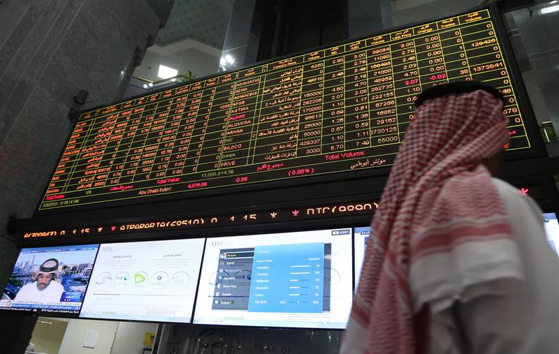 epa06772374 An investor follows the stock market developments on a screen board at the Abu Dhabi Securities Exchange (ADX) in Abu Dhabi, United Arab Emirates, 30 May 2018.  EPA/ALI HAIDER