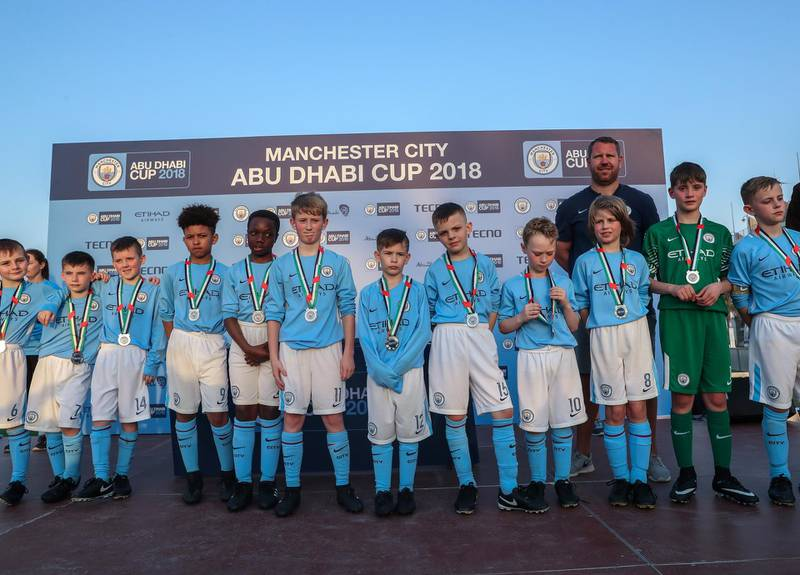 Abu Dhabi, March 24, 2018.  Manchester City Abu Dhabi Cup for juniors.    GoPwin.ro Sports Team takes the U-10 City Cup Victor Besa / The NationalSportsReporter:  Amith Passela