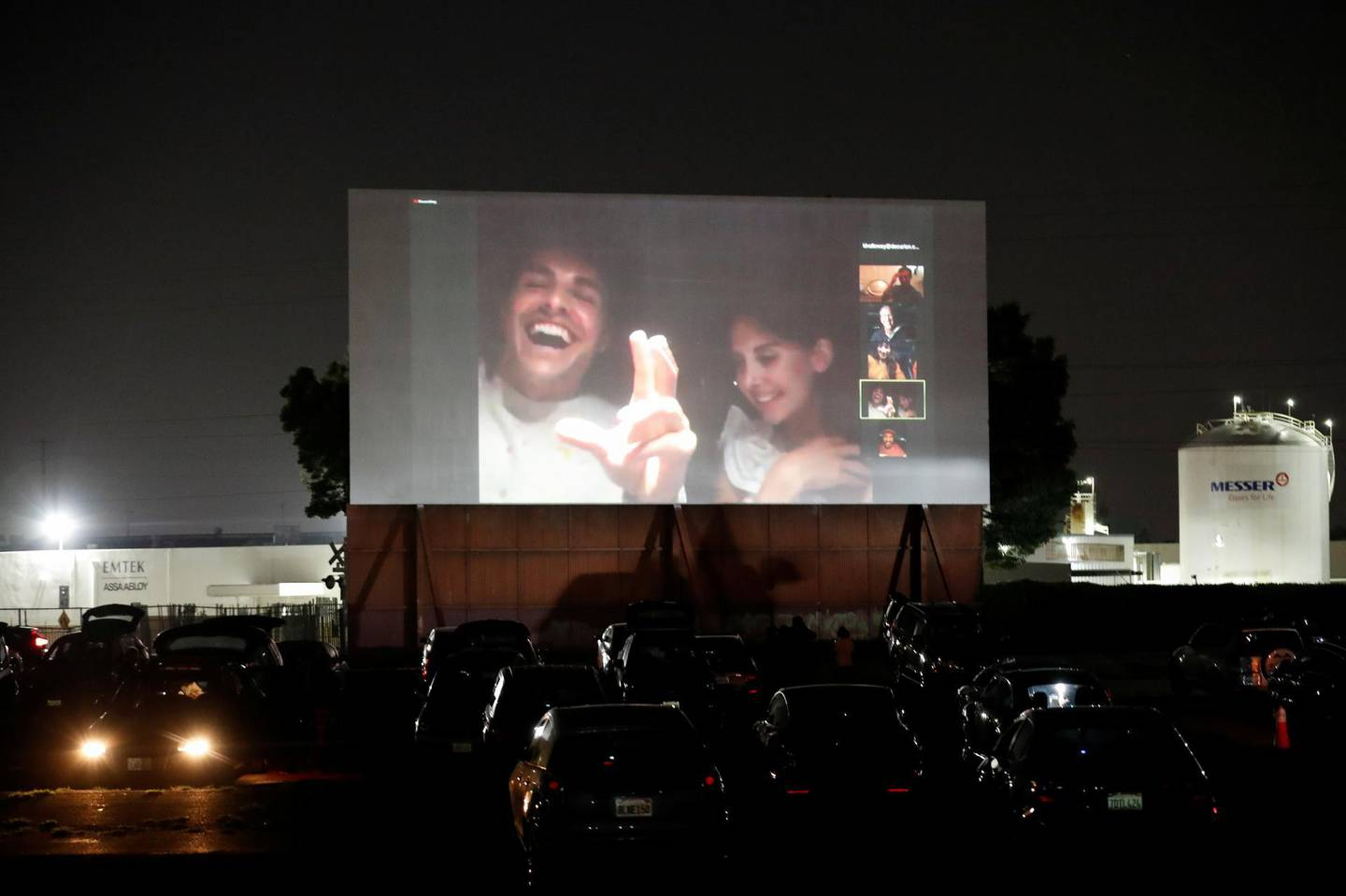 """Director Dave Franco and cast member Alison Brie react as they take part in a Q&A session via Zoom from a vehicle after an advanced screening for the movie """"The Rental"""" at the Vineland Drive-In movie theater in City of Industry, California, U.S. June 18, 2020. REUTERS/Mario Anzuoni"""