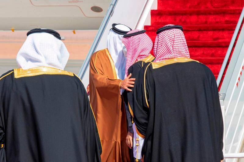 """A handout picture provided by the Saudi Royal Palace on January 5, 2021, shows Crown Prince Mohammed bin Salman (C-R) welcoming Emir of Qatar Tamim bin Hamad Al-Thani (C-L) upon his arrival in the city of al-Ula in northwestern Saudi Arabia for the 41st Gulf Cooperation Council (GCC) summit. Saudi Arabia will reopen its borders and airspace to Qatar, US and Kuwaiti officials said, a major step towards ending a diplomatic rift that has seen Riyadh lead an alliance isolating Doha. The bombshell announcement came on the eve of GCC annual summit in the northwestern Saudi Arabian city of Al-Ula, where the dispute was already set to top the agenda. - RESTRICTED TO EDITORIAL USE - MANDATORY CREDIT """"AFP PHOTO / SAUDI ROYAL PALACE / BANDAR AL-JALOUD"""" - NO MARKETING - NO ADVERTISING CAMPAIGNS - DISTRIBUTED AS A SERVICE TO CLIENTS  / AFP / Saudi Royal Palace / BANDAR AL-JALOUD / RESTRICTED TO EDITORIAL USE - MANDATORY CREDIT """"AFP PHOTO / SAUDI ROYAL PALACE / BANDAR AL-JALOUD"""" - NO MARKETING - NO ADVERTISING CAMPAIGNS - DISTRIBUTED AS A SERVICE TO CLIENTS"""