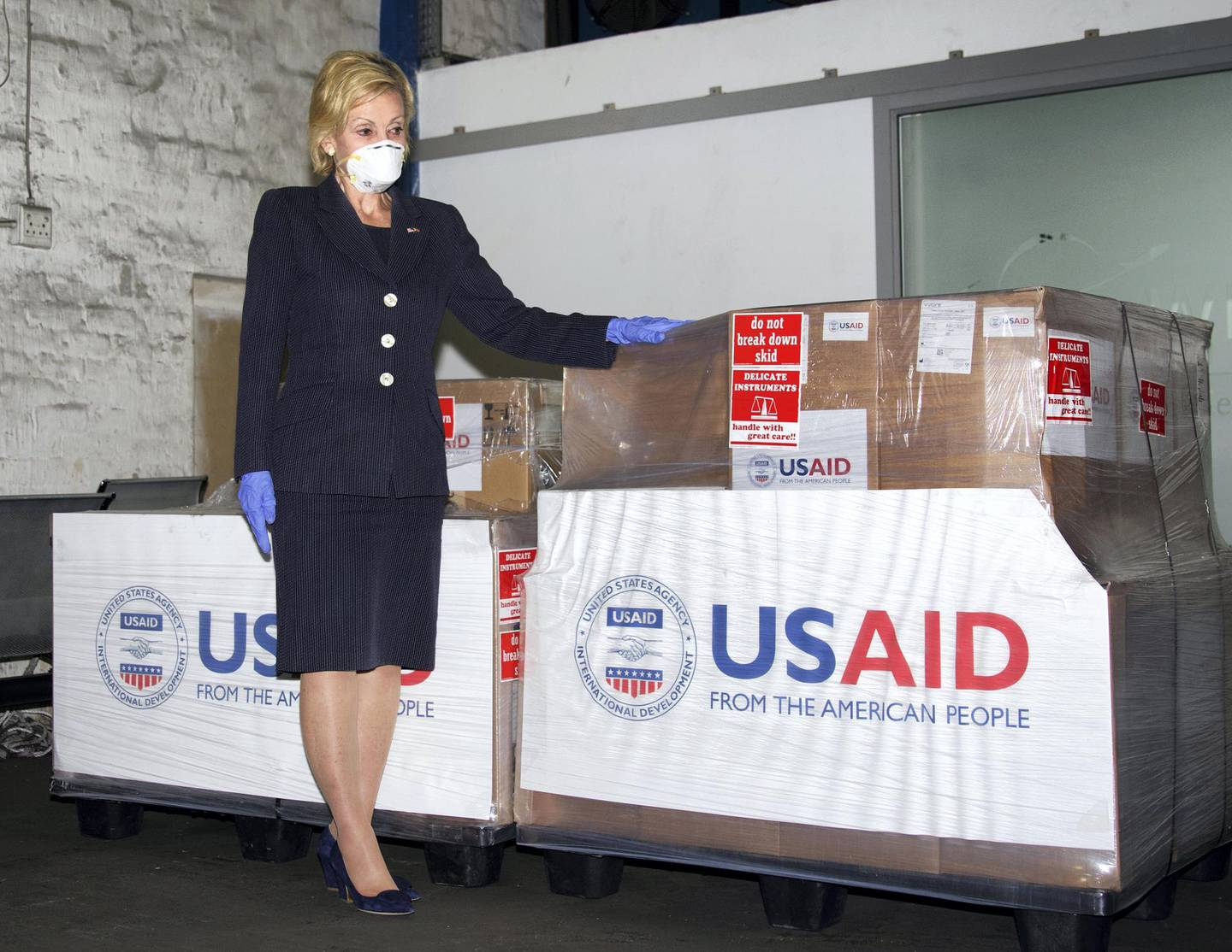In this photo taken Monday May 11, 2020 at OR Tambo Airport Johannesurg and supplied by the United States Embassy in Pretoria, South Africa, showing U.S. Ambassador to South Africa Lana Marks posing with ventilators donated by the U.S. Government. The United State is donating up to 1000 ventilators to assist with South Africa's national response to COVID-19. (Photo/Leon Kgoedi, United States Embassy South Africa via AP)