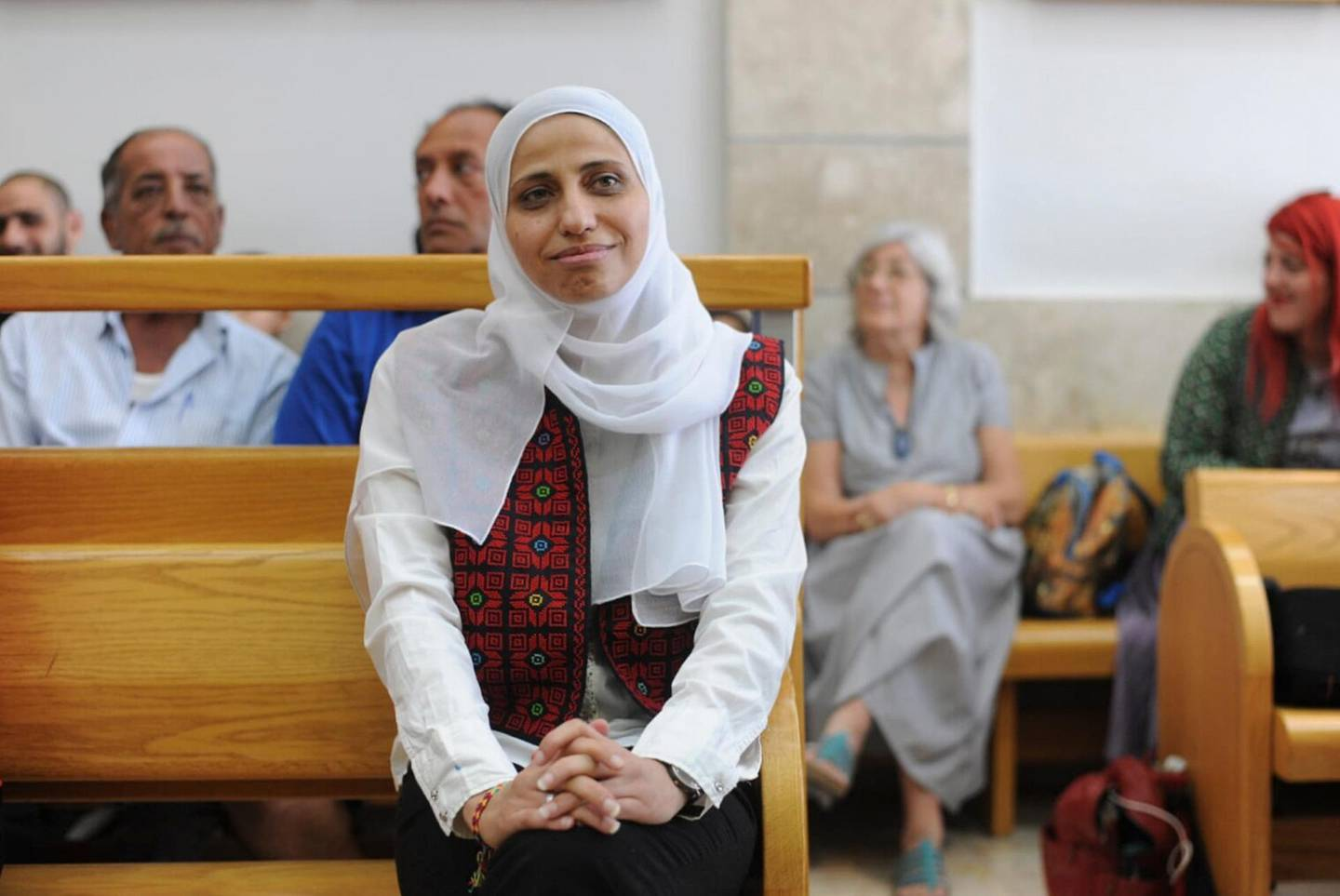 In this Tuesday, July 31, 2018 photo, Arab poet Dareen Tatour sits in a courtroom in Nazareth, Israel. The Israeli court sentenced Tatour to five months in prison for incitement to violence in social media posts she made during a wave of Israeli-Palestinian violence. Tatour's case drew international attention after Israel put her under extended house arrest for her poems. More than 150 literary figures, including authors Alice Walker and Naomi Klein, called for Tatour's release. (AP Photo/Rami Shllush)