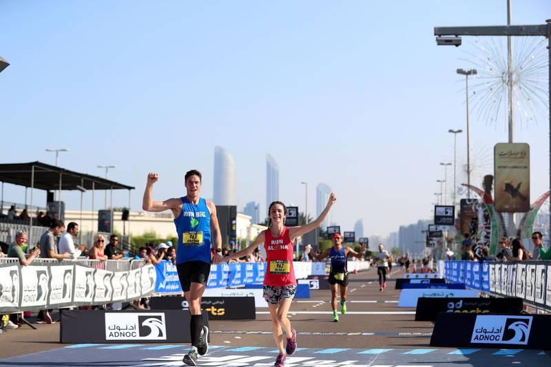 Abu Dhabi, United Arab Emirates - December 06, 2019: Athletes finish the ADNOC Abu Dhabi marathon 2019. Friday, December 6th, 2019. Abu Dhabi. Chris Whiteoak / The National