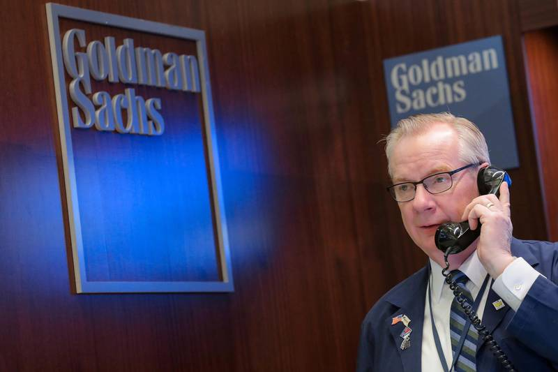 FILE PHOTO: A trader works inside the Goldman Sachs booth on the floor of the New York Stock Exchange (NYSE) in New York, U.S., March 7, 2019. REUTERS/Brendan McDermid/File Photo