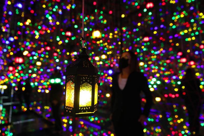 Dubai, United Arab Emirates - Reporter: N/A. Standalone. Ramadan. People visit the Ramadan Reflection room at Ibn Battuta Mall. The room is filled with coloured hanging lamps and mirrors all around. Tuesday, April 20th, 2021. Dubai. Chris Whiteoak / The National