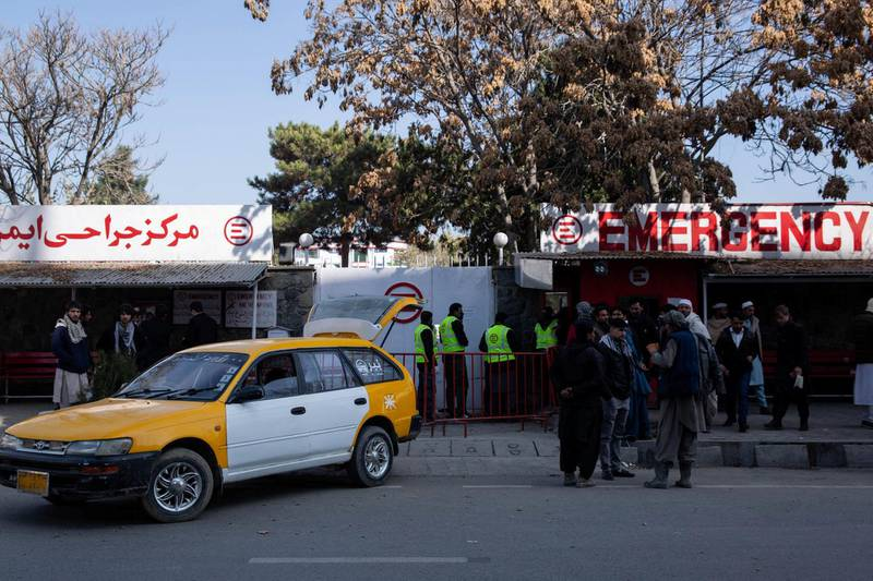 People wait outside Kabul's Emergency Hopsital in Share-Naw where at least 30 injured have been brought.