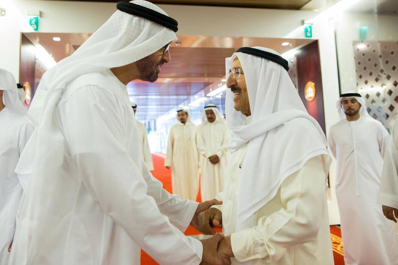 ABU DHABI, UNITED ARAB EMIRATES - October 13, 2014: HH General Sheikh Mohamed bin Zayed Al Nahyan Crown Prince of Abu Dhabi and Deputy Supreme Commander of the UAE Armed Forces (L) bids farewell to HH Sheikh Sabah Al-Ahmad Al-Jaber Al-Sabah Emir of Kuwait (R) at the Presidential Airport, after a lunch meeting at Etihad Towers.   ( Mohamed Al Hammadi / Crown Prince Court - Abu Dhabi ) ---