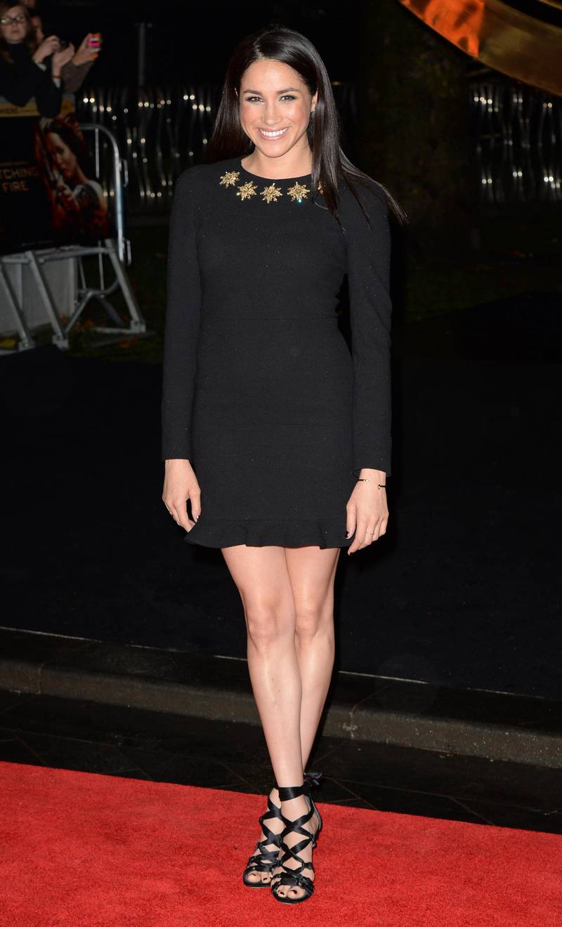 """LONDON, UNITED KINGDOM - NOVEMBER 11: Meghan Markle attends the UK Premiere of """"The Hunger Games: Catching Fire"""" at Odeon Leicester Square on November 11, 2013 in London, England. (Photo by Zak Hussein/Getty Images)"""