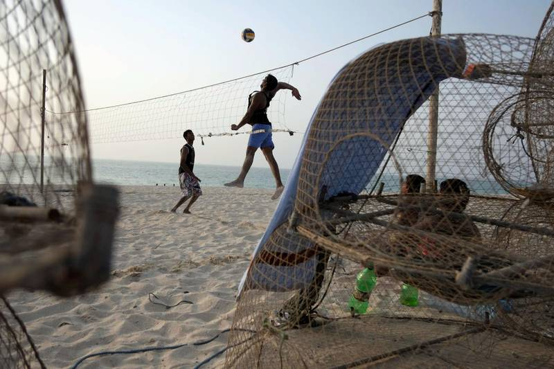 DUBAI, UNITED ARAB EMIRATES,  July 20, 2012. Indian fisherman play beach volley ball with a home made net on Jumeirah beach in the afternoon of the first day of Ramadan. FOCAL POINT (ANTONIE ROBERTSON / The National)