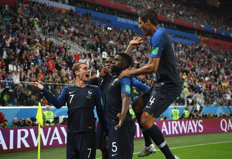 SAINT PETERSBURG, RUSSIA - JULY 10:  Samuel Umtiti of France celebrates with team mates after scoring his team's first goal during the 2018 FIFA World Cup Russia Semi Final match between Belgium and France at Saint Petersburg Stadium on July 10, 2018 in Saint Petersburg, Russia.  (Photo by Shaun Botterill/Getty Images)