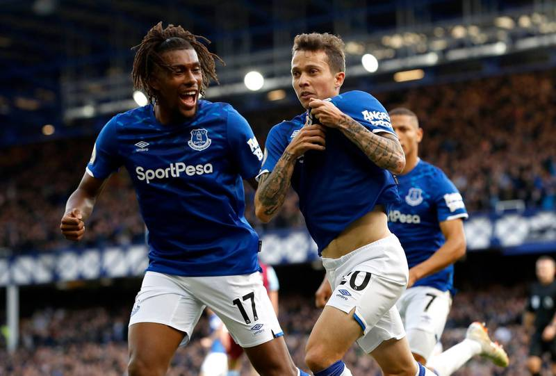 Everton's Bernard, right, celebrates scoring his side's first goal of the game against West Ham, with teammate Alex Iwobi, left, during their English Premier League soccer match at Goodison Park in Liverpool, England, Saturday Oct. 19, 2019. (Martin Rickett/PA via AP)