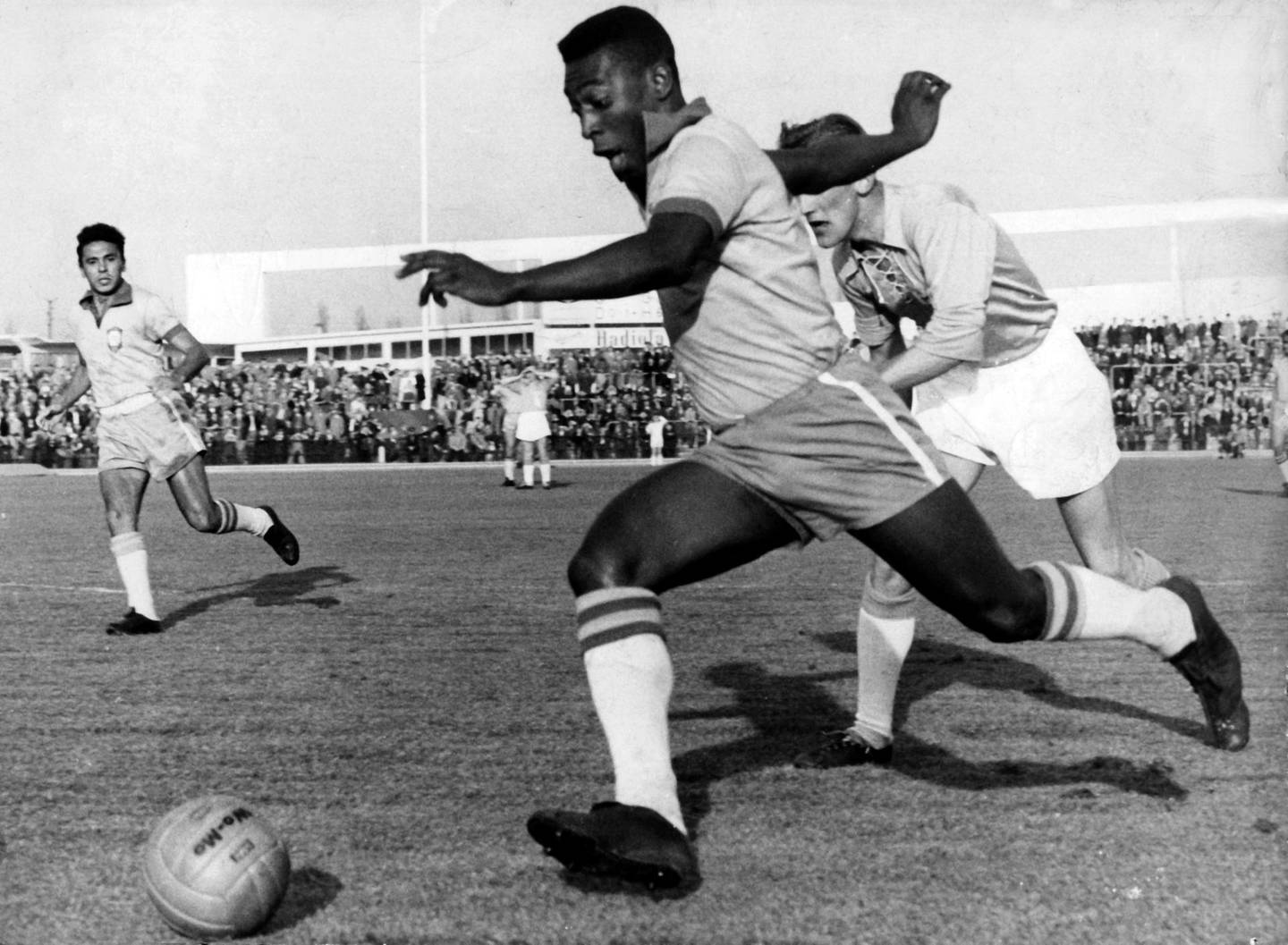 Brazilian striker Pele (front) runs with the ball past a Swedish defender of the Malmoe FF soccer club during an international friendly between Malmoe FF and the Brazilian national team in Malmoe, Sweden, 8 May 1960. Brazil won 7-1. Pele became famous when he played with the Brazilian national team at the 1958 FIFA World Cup in Sweden and won the first World Champion title for Brazil.