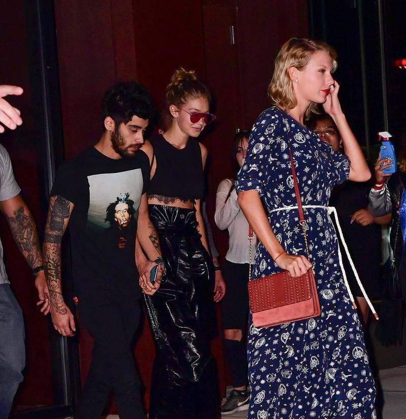 NEW YORK, NY - SEPTEMBER 12:  Zayn Malik, Gigi Hadid and Taylor Swift leave Gigi Hadid's apartment on September 12, 2016 in New York City.  (Photo by James Devaney/GC Images)