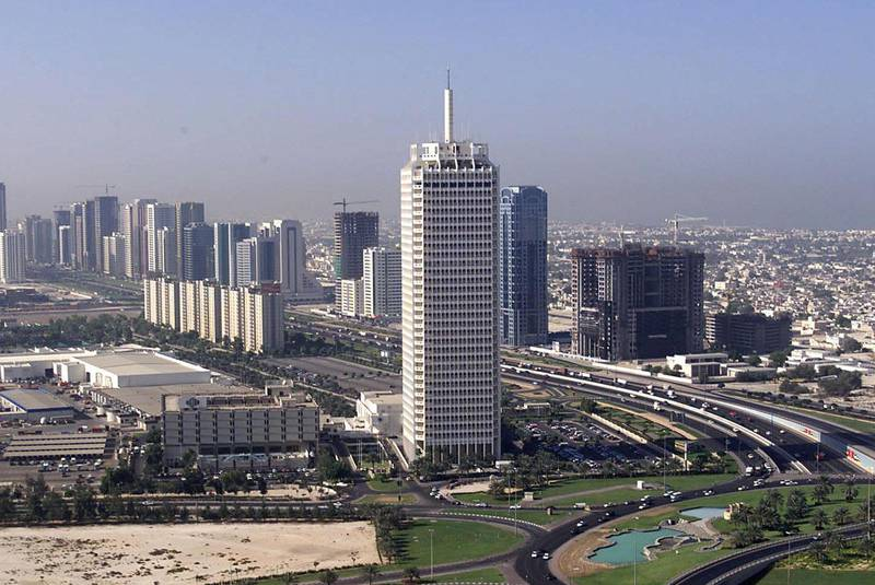 Aerial view of Dubai's World Trade Center (C) taken 12 November 1999. Oil was discovered in the emirate of Dubai in 1966 and its first oil exports three years later saw the trading town develop into a modern city with a population of around 800,000 people. (Electronic Image) (Photo by RABIH MOGHRABI / AFP)