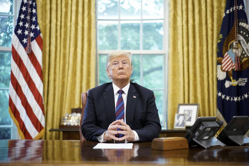 """(FILES) In this file photo taken on August 27, 2018, US President Donald Trump listens during a phone conversation with Mexico's President Enrique Pena Nieto on trade in the Oval Office of the White House in Washington, DC. - Trump on September 1, 2018, threatened to exclude Canada from a new NAFTA agreement after negotiations to rewrite the pact ended without an agreement on August 31. """"There is no political necessity to keep Canada in the new NAFTA deal. If we don't make a fair deal for the US after decades of abuse, Canada will be out,"""" he tweeted. (Photo by MANDEL NGAN / AFP)"""