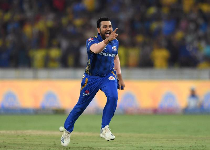 Mumbai Indians cricket captain Rohit Sharma celebrates after winning the 2019 Indian Premier League (IPL) Twenty20 final cricket match between Mumbai Indians and Chennai Super Kings at the Rajiv Gandhi International Cricket Stadium in Hyderabad on May 12, 2019. (Photo by NOAH SEELAM / AFP) / ----IMAGE RESTRICTED TO EDITORIAL USE - STRICTLY NO COMMERCIAL USE-----