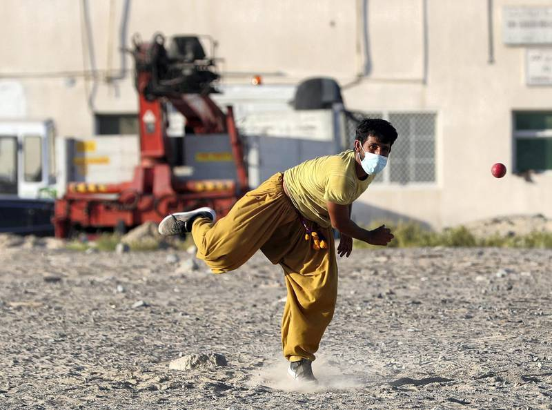 Dubai, United Arab Emirates - Reporter: N/A. News. Coronavirus/Covid-19. A gentleman plays tape ball cricket with a mask on to prevent the spread of Covid-19. Wednesday, October 21st, 2020. Dubai. Chris Whiteoak / The National
