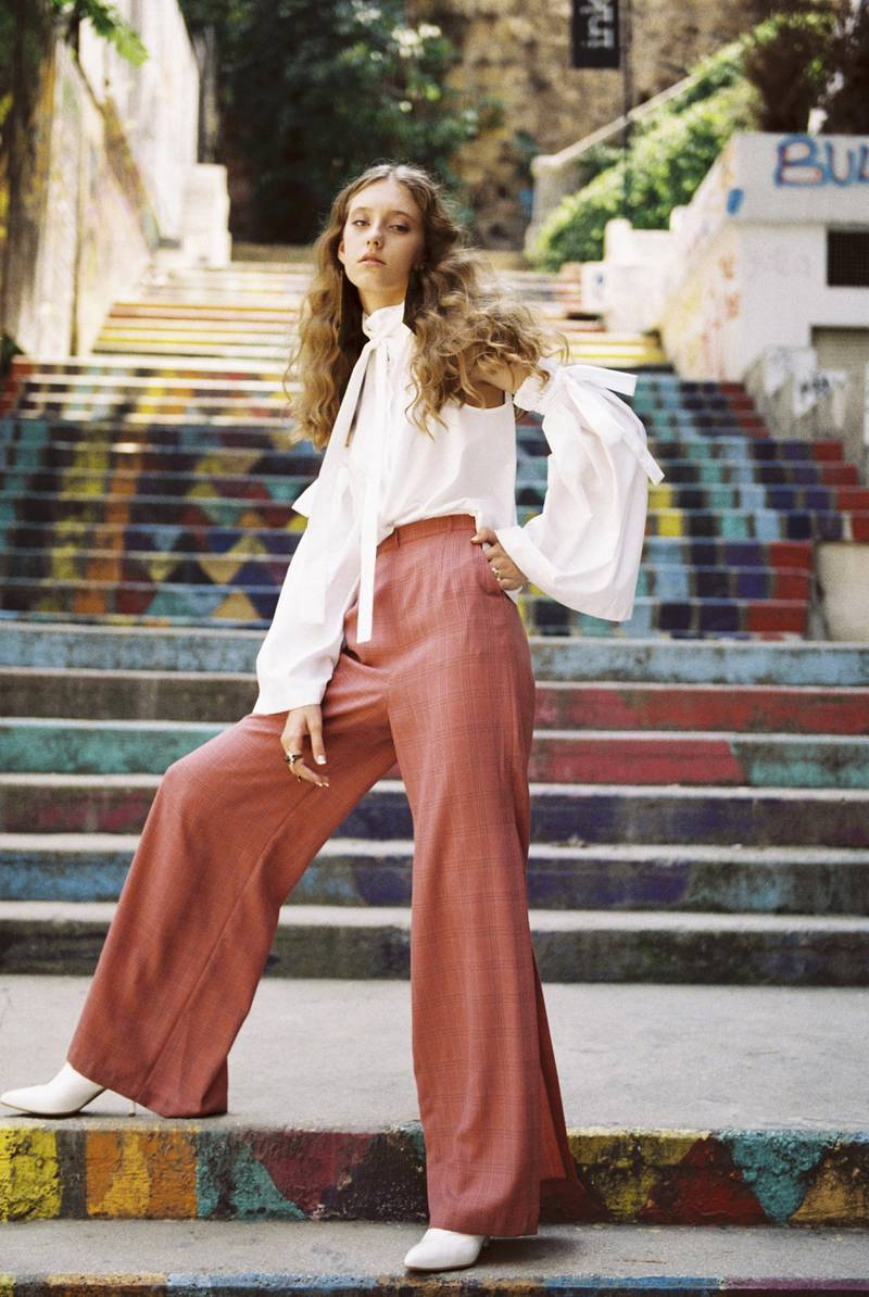 OWN THE STREETS.Photography   Bachar Srourfashion direction   sarah maiseystyling   hafsa lodiShirt, Dh735; trousers, Dh955, both from Roni Helou. Ring, right hand, index finger, Dh1,650, Gucci. Ring, right hand, ring finger, Dh1,100, Christian Dior. Ring, left hand, Dh202, Dina B at Lebelik.com. Shoes, Dh2,935, Stuart Weitzman. Earrings, stylist's own