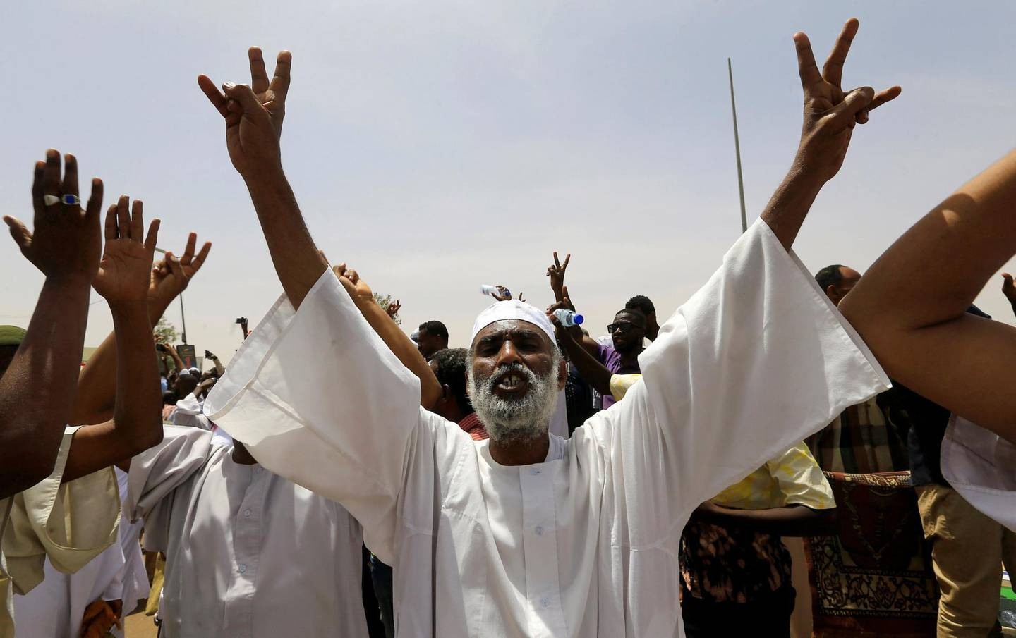 A Sudanese demonstrator chants slogans as he protests against the army's announcement that President Omar al-Bashir would be replaced by a military-led transitional council, near Defence Ministry in Khartoum, Sudan April 12, 2019. REUTERS/Stringer