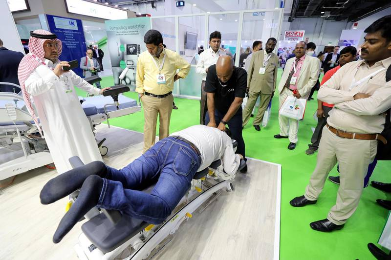Dubai, United Arab Emirates - Reporter: Dan Sanderson: Hakim Hassan from the Finland Osteopathy clinic performs physio. Thousands of people gather for the Arab Health conference. Monday, January 27th, 2020. World trade centre, Dubai. Chris Whiteoak / The National