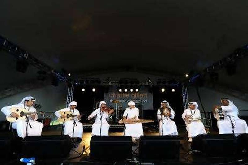Takht Al Emarat perform on the second day of the Womad Festival, in Malmesbury in Wiltshire.