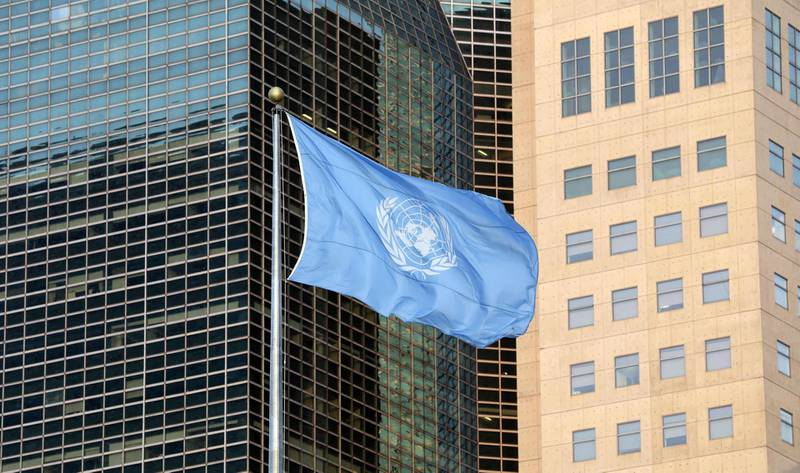 """(FILES) In this file photo the United Nations flag is seen is seen during the Climate Action Summit 2019 at the United Nations General Assembly Hall September 23, 2019 in New York City. UN Secretary-General Antonio Guterres on September 21, 2020 deplored the lack of multilateral solutions to global challenges as he opened a summit for the world body's 75th anniversary. """"No one wants a world government -- but we must work together to improve world governance,"""" Guterres said at the UN General Assembly rostrum ahead of virtual speeches by world leaders.  / AFP / Ludovic MARIN"""