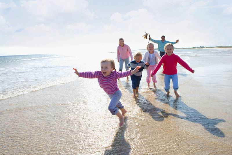 Young happy family running on beach (Getty Images) *** Local Caption ***  wk15ap-family-main.jpg