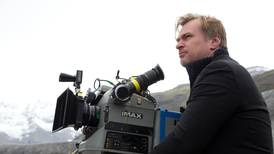 Why did Christopher Nolan choose to part ways with Warner Bros for his new film?