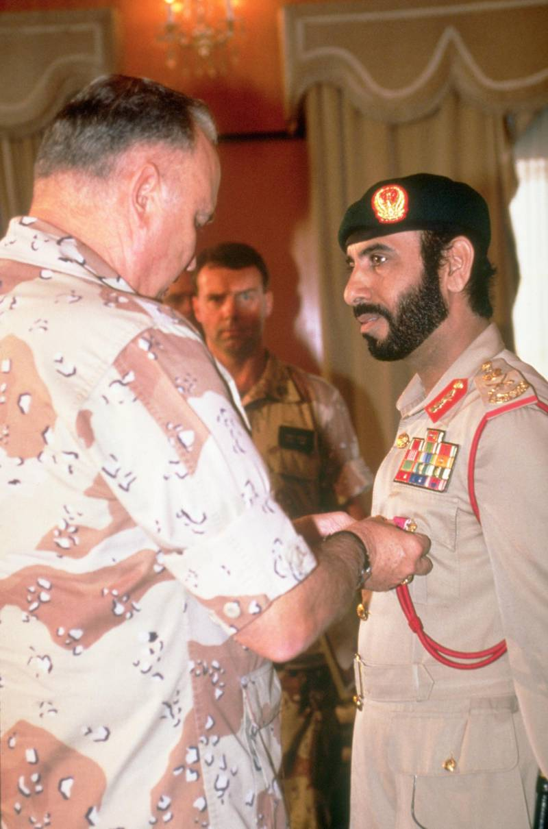 General Norman Schwarzkopf, commander-in-chief, U.S. Central Command, presents the Legion of Merit to Major General Muhammed Said Al-Badi, chief of staff, U.A.E. armed forces, for his role in liberating Kuwait from occupying Iraqi forces during Operation Desert Storm. April 2, 1991. (Photo by © CORBIS/Corbis via Getty Images)