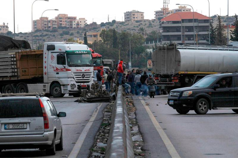 Lebanese anti-government protesters block the Sidon-Beirut highway in the town of Jiyeh, south of the Lebanese capital Beirut, on January 3, 2020. Lebanon is without a cabinet and in the grips of a deepening economic crisis after a two-month-old protest movement forced Saad Hariri to stand down as prime minister on October 29. / AFP / Mahmoud ZAYYAT