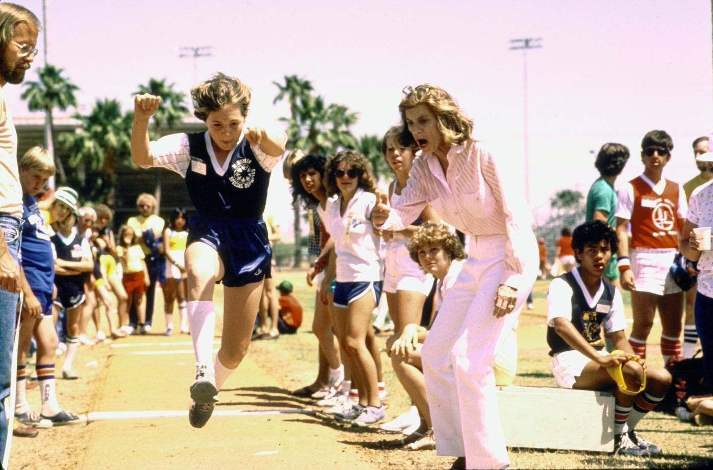 Eunice Kennedy (R) encouraging Special Olympian Karen Fosdick on her way to a gold medal.  (Photo by John Dominis/The LIFE Images Collection/Getty Images)