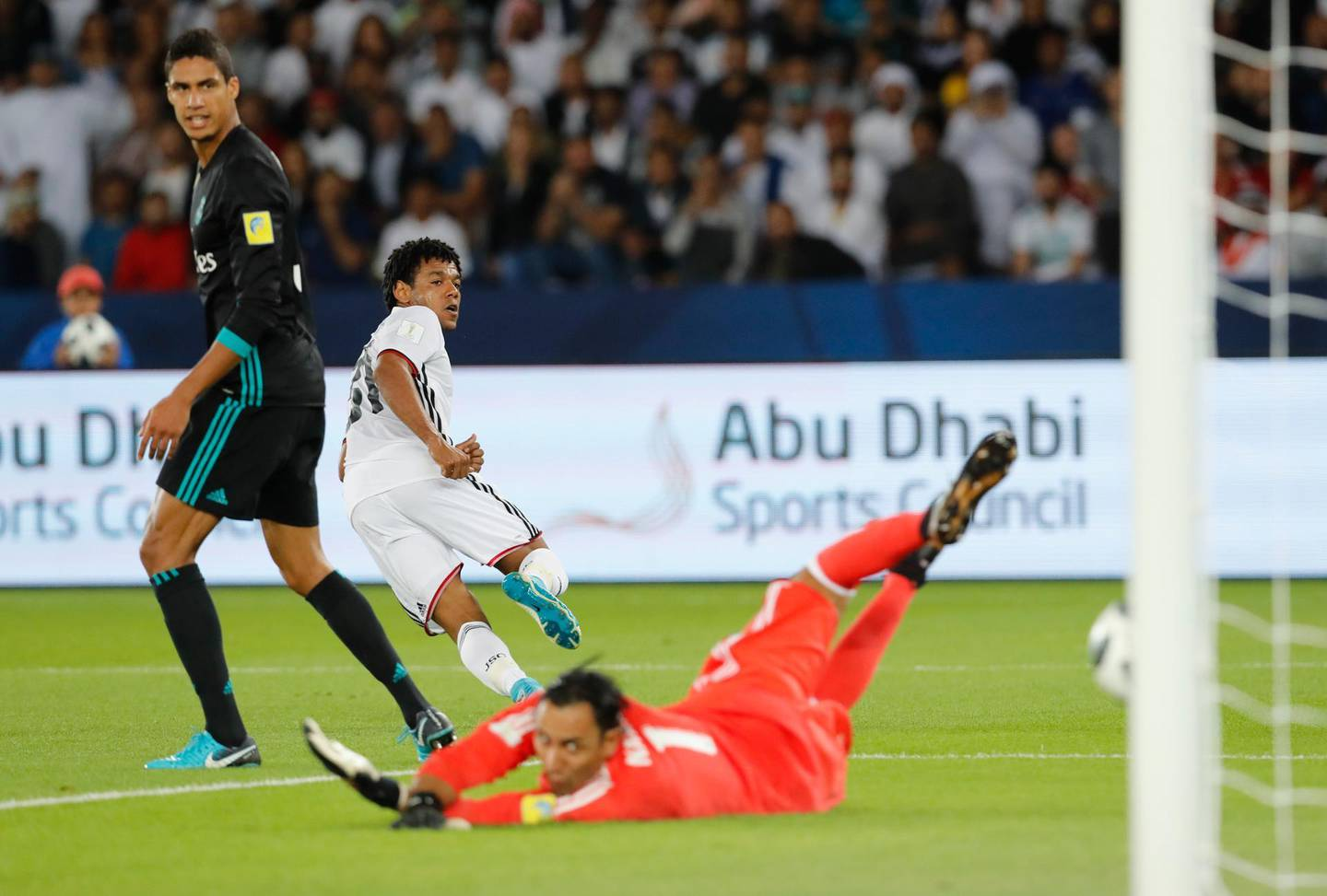 Al Jazira's Romarinho, left, scores the opening goal during the Club World Cup semifinal soccer match between Real Madrid and Al Jazira Club at Zayed sport city in Abu Dhabi, United Arab Emirates, Wednesday, Dec. 13, 2017. (AP Photo/Hassan Ammar)