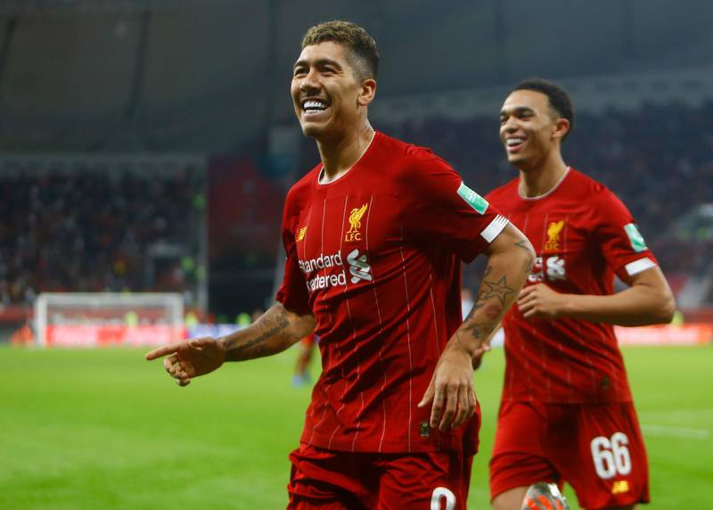 Liverpool's Roberto Firmino, left, celebrates after a goal after the Club World Cup semifinal soccer match between Liverpool and Monterrey at the Khalifa International Stadium in Doha, Qatar, Wednesday, Dec. 18, 2019. (AP Photo/Hussein Sayed)
