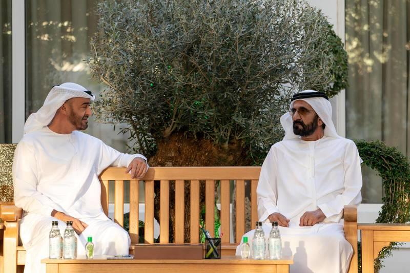 DUBAI, UNITED ARAB EMIRATES - March 15, 2020: HH Sheikh Mohamed bin Zayed Al Nahyan, Crown Prince of Abu Dhabi and Deputy Supreme Commander of the UAE Armed Forces (back L) meets with HH Sheikh Mohamed bin Rashid Al Maktoum, Vice-President, Prime Minister of the UAE, Ruler of Dubai and Minister of Defence (back R), at Al Marmoum.  ( Rashed Al Mansoori / Crown Prince Court - Abu Dhabi ) ---