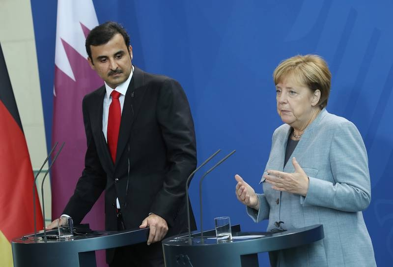 BERLIN, GERMANY - SEPTEMBER 15:  German Chancellor Angela Merkel and Emir of Qatar Sheikh Tamim bin Hamad Al Thani speak to the media following talks at the Chancellery on September 15, 2017 in Berlin, Germany. The two discussed the current tensions between Qatar and some its neighbors, among other issues. (Photo by Sean Gallup/Getty Images)