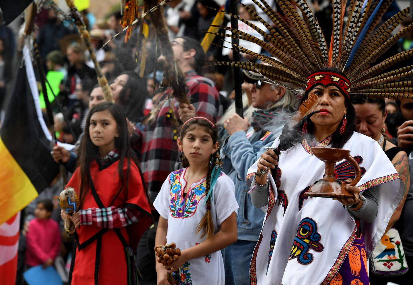 (FILES) In this file photo Native Americans lead demonstrators as they march to the Federal Building in protest against President Donald Trump's executive order fast-tracking the Keystone XL and Dakota Access oil pipelines, in Los Angeles, California on February 5, 2017. President-elect Joe Biden plans to scrap the permit for the controversial Keystone XL oil pipeline between Canada and the US, two Canadian broadcasters said on January 17, 2021. CBC and CTV cited sources and notes from Biden's transition team that indicate he will rescind the permit via executive order following his inauguration on January 20, 2021. / AFP / Mark RALSTON